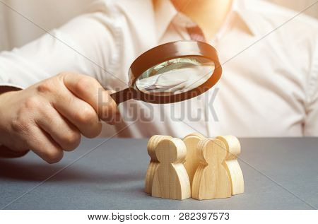 Business Leader Holding A Magnifying