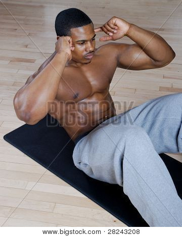 African American Doing Sit Ups And Crunches