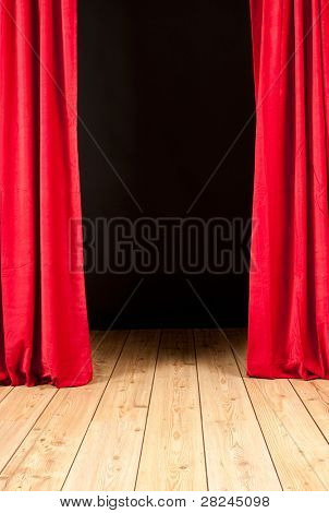 stage theater with red curtain and wood floor
