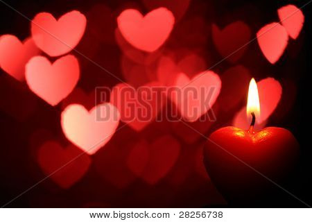 Burning heart-shape candles for Valentine's Day