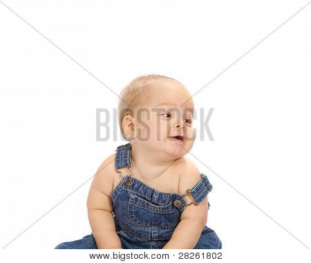 Little Boy Sitting in Coveralls