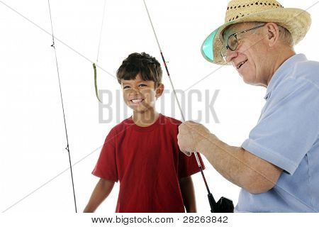 A happy preschooler watching the wiggly worm baited on his grandpa's fishing line.  Motion blur on worm and fishing line.  Focus on boy.  On a white background.