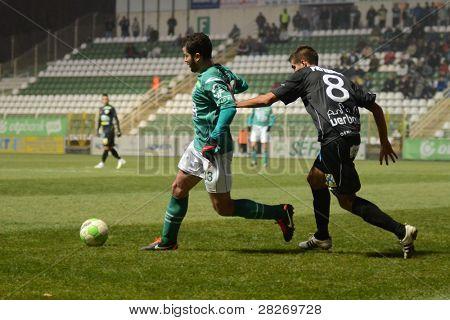 KAPOSVAR, HUNGARY - NOVEMBER 26: Pedro Sass (in green) in action at a Hungarian National Championship soccer game Kaposvar (green) vs Kecskemet (black) November  26, 2011 in Kaposvar, Hungary.