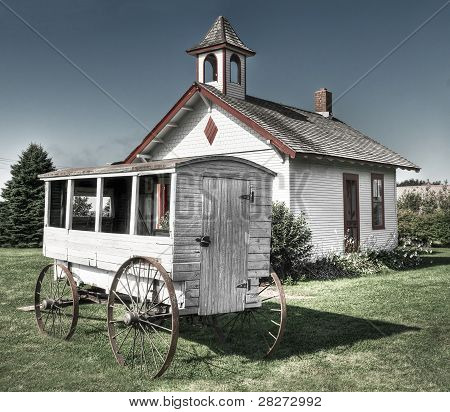 School Wagon In Front Of One-room Schoolhouse