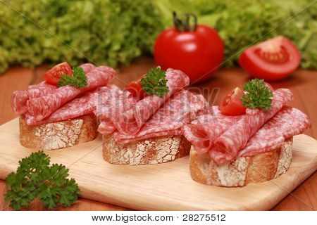 Fingerfood With Salami And Tomatos