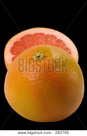 Couple Half Of Grapefruit Isolated On Black Background