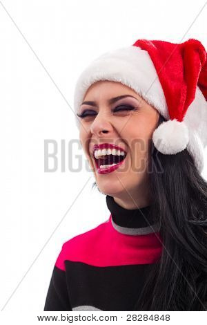 Closeup portrait of Pretty  smiling Santa girl wearing Christmas hat, isolated over white background