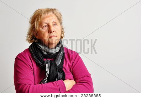 Senior Woman In Pink With Crossed Arms