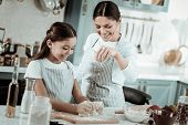 Happy Mother And Daughter Cooking A Tasty Dinner Together poster