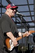 CLARK, NJ - SEPT 18: Lead singer and guitar player Pat DiNizio of the band The Smithereens performs