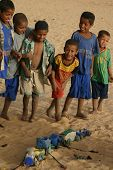 Berber Nomad Children in the Sahara Desert With Homemade Toys