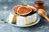Brie Or Camembert Cheese With Fig And Honey On Plate. Tasty White Cheese Closeup View poster