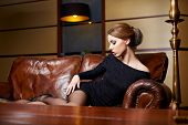 foto of snob  - Beautiful elegant woman in a luxury hotel - JPG