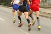 Runners legs on the road with panning blur