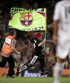 BARCELONA - AUG 22: An unidentified Spontaneous supporter of Barcelona runs onto the field during a