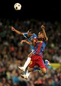 BARCELONA - APRIL 9: Kale Uche(L) of Almeria fights with Keita(R) of Barcelona during the match betw