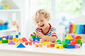 Kids Toys. Child Building Tower Of Toy Blocks. poster