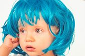 Funky Style Beauty. Cute Baby With Long Blue Hair. Small Child Wear Blue Wig Hair. Small Kid In Fanc poster