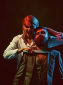 Halloween And Horror Concept. Couple With Halloween Makeup. Wicked Woman Hold Knife To Man Neck, Hal poster