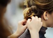 Young Woman/bride Getting Her Hair Done Before Wedding Or Party. Wedding Or Prom Ball Hairstyles. poster