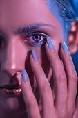Young Stylish Girl With Bright Makeup With A Hand Near The Face. In The Neon Shade The Face Of The M poster