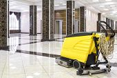 Cleaning Machine In The Empty Office Lobby. Yellow Vacuum Equipment For Cleaning Is On The Shiny Mar poster