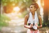 Portrait Young Attractive Fit Woman With White Towel Resting After Workout Sport Exercises Outdoors  poster
