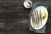 Seafood. Small Sea Small Fish Smelt, Anchovies, Sardines In The Form For Cooking With Oil, Salt And  poster