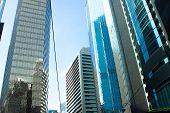 Bottom View Building With Glass Facade In Modern Hong Kong City. Glass Facade Skyscraper In Urban Ar poster