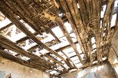 Ruined House With Partially Collapsed Wood Ceiling. Decaying Wood Ceiling. Ruined House With Broken  poster