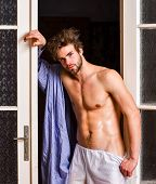 Sexy Lover Concept. Sexy Attractive Macho Tousled Hair Coming Out Through Bedroom Door. Bachelor Sex poster
