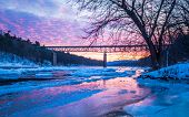 Icy Delaware River Reflects The Vivid Sunset Near Milford Bridge, Pa poster