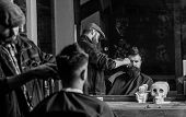 Reflexion Of Barber With Clipper Trimming Hair Of Client. Hipster Client Getting Haircut. Barber Wit poster