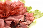 picture of profusion  - salami and lettuce on the white background - JPG