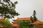 Traditional Pagoda Roof Of Historical Architecture Of Temple Near Big Buddha In Hongkong. poster
