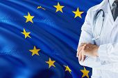 European Doctor Standing With Stethoscope On European Union Flag Background. National Healthcare Sys poster