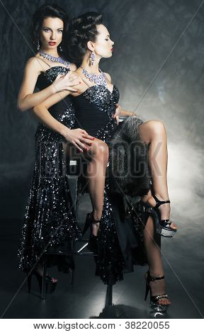 Homosexual Couple Of Young Flirting Women In Erotic Pose