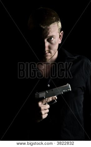 Male With Gun To Chest