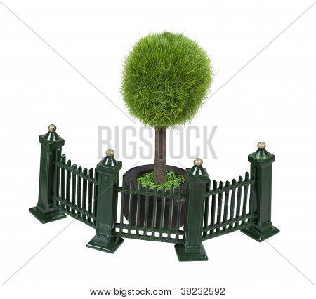 Metal Fence Next To Potted Tree