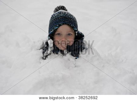Young Boy Covered With Snow