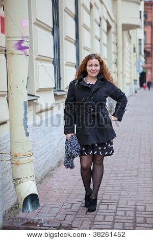 Pretty Woman In The City Streets Standing Near Waterdrain