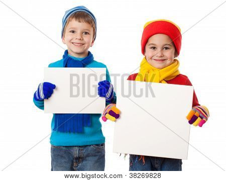 Kids in winter clothes with empty blanks
