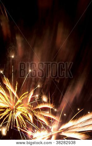 Golden Fireworks Burst And Copy Space