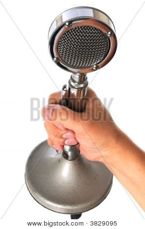 Hand Holding Vintage Microphone