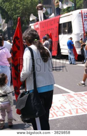 Woman Holding Red Flag At A Demonstration