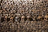 stock photo of doomsday  - Scary Skulls and Bones in the Catacombs of Paris - JPG