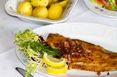 foto of flounder  - festive table with flounder and potatoes dinner - JPG