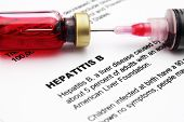stock photo of hepatitis  - Close up concept of syringe and pills on Hepatitis
