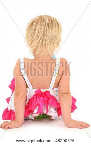 Back side of preschool girl on white background sitting.  Clipping path.