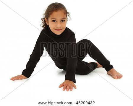 Beautiful hispanic preschool girl sitting on white floor with clipping path.